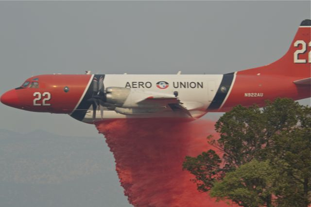 Fire fighting plane dropping retardant